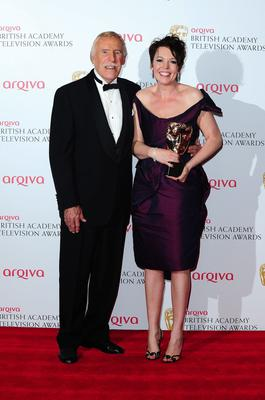 Presenter Bruce Forsythe with winner Olivia Coleman with the best Female in a comedy Award for Twenty Twelve at the 2013 Arqiva British Academy Television Awards at the Royal Festival Hall, London. PRESS ASSOCIATION Photo. Picture date: Sunday May 12, 2013. See PA story SHOWBIZ Bafta. Photo credit should read: Ian West/PA Wire