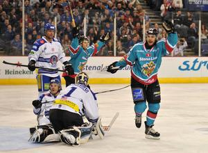 21/12/13: Kevin Saurette of the Belfast Giants celebrates after the first goal against the Coventry Blaze during the Elite League game at the Odyssey Arena.