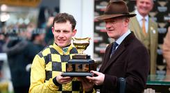 Paul Townend (left) and trainer Willie Peter Mullins celebrates victory at the Magners Cheltenham Gold Cup Chase during Gold Cup Day of the 2019 Cheltenham Festival at Cheltenham Racecourse. Nigel French/PA Wire.