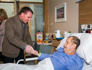 Celtic manager Brendan Rodgers shaking the hand of patient Hubert Cowan from Whitehead