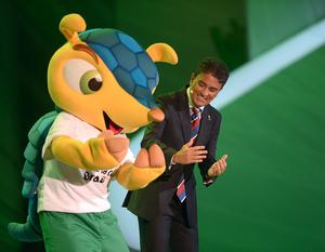 Former Brazilian player Bebeto with Mascot Fuleco during the FIFA 2014 World Cup Draw at the Costa Do Sauipe, Bahia, Brazil.