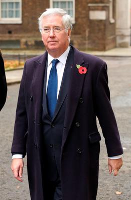 Defence Secretary Michael Fallon walks through Downing Street on his way to the annual Remembrance Sunday service at the Cenotaph memorial in Whitehall. Chris Radburn/PA Wire.