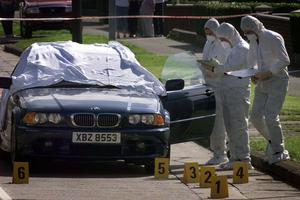 Police and forensics at the scene of Stephen Warnock killing.