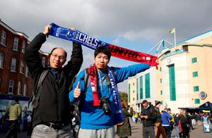 "Fans hold a Chelsea and Manchester United half scarf outside Stamford Bridge before the Premier League match at Stamford Bridge, London. PRESS ASSOCIATION Photo. Picture date: Sunday October 23, 2016. See PA story SOCCER Chelsea. Photo credit should read: Nick Potts/PA Wire. RESTRICTIONS: EDITORIAL USE ONLY No use with unauthorised audio, video, data, fixture lists, club/league logos or ""live"" services. Online in-match use limited to 75 images, no video emulation. No use in betting, games or single club/league/player publications."