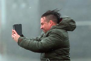 "A man take selfies in waves and high wind at Lahinch in County Clare on the West Coast of Ireland as Hurricane Ophelia hits the UK and Ireland with gusts of up to 80mph. PRESS ASSOCIATION Photo. Picture date: Monday October 16, 2017. The tropical storm has made its way across the Atlantic and Ophelia's remnants reached home shores on Monday, resulting in ""exceptional"" weather - exactly 30 years after the Great Storm of 1987 killed 18 people. See PA story WEATHER Ophelia. Photo credit should read: Niall Carson/PA Wire"
