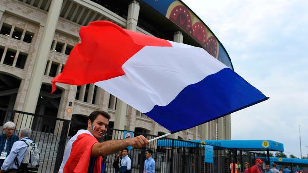 A France's supporter waves his national flag ahead of the Russia 2018 World Cup final football match between France and Croatia at the Luzhniki Stadium in Moscow on July 15, 2018. / AFP PHOTO / Kirill KUDRYAVTSEVKIRILL KUDRYAVTSEV/AFP/Getty Images