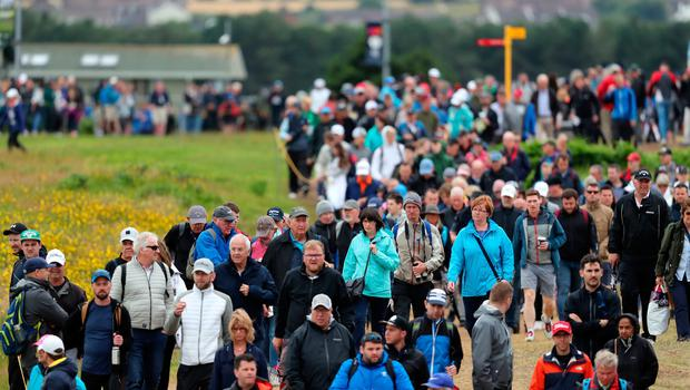 Large crowds gather around the 2nd green during day four of The Open Championship 2019 at Royal Portrush Golf Club. PRESS ASSOCIATION Photo. Picture date: Sunday July 21, 2019. See PA story GOLF Open. Photo credit should read: Niall Carson/PA Wire. RESTRICTIONS: Editorial use only. No commercial use. Still image use only. The Open Championship logo and clear link to The Open website (TheOpen.com) to be included on website publishing.
