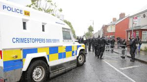 Police erect a barrier ahead of the contentious orange order parade  at the stopping point on the Woodvale road during July 12th celebrations in Belfast , 2016 ( Photo by Kevin Scott / Presseye)