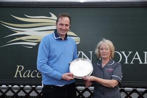 Northern Ireland Festival of Racing at Down Royal Racecourse - Day 1  Race 6 (3:45) Robinson Services Handicap Chase   Sponsors Anita Wilson from Robinsons Services presents DecadePlayer trainer Philip Rothwell.  Picture by Kelvin Boyes / Press Eye.