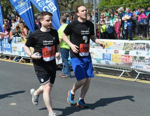 Pacemaker Press 1/5/2017 Runners at the finish line at  the Belfast City Marathon on Bank Holiday Monday, with over 15,000 people taking part threw the streets of Belfast, with the Finish line at Ormeau Park. Pic Colm Lenaghan/Pacemaker
