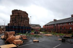 "A bonfire under construction near Chobam Street, Belfast, as building continues on huge loyalist bonfires, which are traditionally lit on the ""Eleventh night"" to usher in the Twelfth commemorations. PRESS ASSOCIATION Photo. Picture date: Sunday July 10, 2016. Authorities in Northern Ireland are cautiously optimistic the main fixture in the loyal order parading season can pass off peacefully, but have a major policing operation planned to deal with any unrest. See PA story ULSTER Twelfth. Photo credit should read: Brian Lawless/PA Wire"