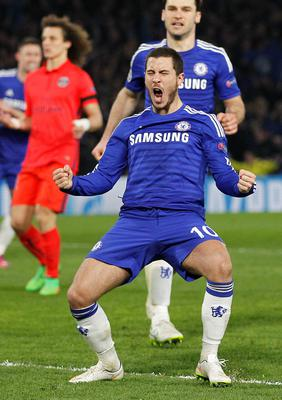 Chelsea's Belgian midfielder Eden Hazard celebrates after scoring his team's second goal during the UEFA Champions League round of 16 second leg football match between Chelsea and Paris Saint-Germain at Stamford Bridge in London on March 11, 2015.  AFP PHOTO / IAN KINGTONIAN KINGTON/AFP/Getty Images