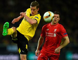Dortmund's midfielder Sven Bender (L) and Liverpool's Croatian defender Dejan Lovren  vie for the ball during the UEFA Europe League quarter-final, first-leg football match Borussia Dortmund vs Liverpool FC in Dortmund, western Germany on April 7, 2016. / AFP PHOTO / PATRIK STOLLARZPATRIK STOLLARZ/AFP/Getty Images