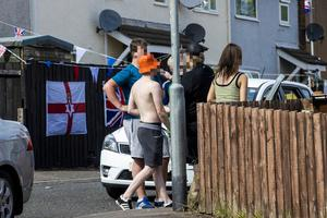 People drinking on the street close to the Westlands Road in north Belfast, during the C-19 lockdown.