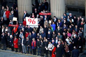 Members of the public attend a commemorative event at St George's Hall in Liverpool, to mark the outcome of the Hillsborough inquest which ruled that 96 Liverpool fans who died as a result of the Hillsborough disaster were unlawfully killed. PRESS ASSOCIATION Photo. Picture date: Wednesday April 27, 2016. See PA story INQUEST Hillsborough. Photo credit should read: Peter Byrne/PA Wire