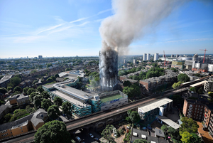 Smoke rises from the building after a huge fire engulfed the 24 story Grenfell Tower in Latimer Road, West London in the early hours of this morning on June 14, 2017 in London, England. (Photo by Leon Neal/Getty Images)