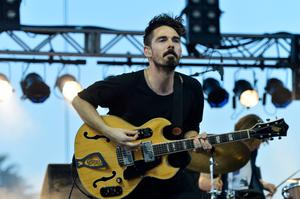 INDIO, CA - APRIL 12:  Musician Taylor Rice of Local Natives performs onstage during day 1 of the 2013 Coachella Valley Music & Arts Festival at the Empire Polo Club on April 12, 2013 in Indio, California.  (Photo by Frazer Harrison/Getty Images for Coachella)