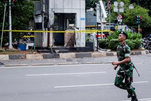 JAKARTA, INDONESIA - JANUARY 14:  Indonesian military guard the blast site after a series of explosions hit the Indonesia capital on January 14, 2016 in Jakarta, Indonesia. Reports of explosions and gunshots in the centre of the Indonesian capital, including outside the United Nations building and in the front of the Sarinah shopping mall, an area with many luxury hotels, embassies and offices.  (Photo by Oscar Siagian/Getty Images)