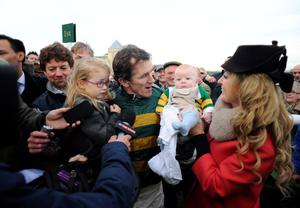 TOWCESTER, ENGLAND - NOVEMBER 07:  Tony McCoy riding Mountain Tunes (C) celebrates victory to give Tony McCoy his 4000th career win in The Weatherbys Novices' Hurdle Race with daughter Eve and son Archie Peter and wife Chanelle at Towcester racecourse on November 07, 2013 in Towcester, England. (Photo by Alan Crowhurst/Getty Images)