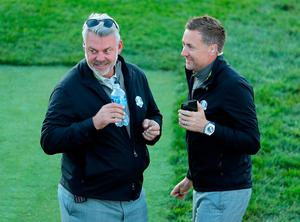 CHASKA, MN - OCTOBER 01: Captain Darren Clarke of Europe speaks to vice-captain Ian Poulter during morning foursome matches of the 2016 Ryder Cup at Hazeltine National Golf Club on October 1, 2016 in Chaska, Minnesota.  (Photo by David Cannon/Getty Images)