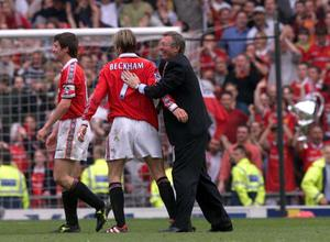 File photo dated 16/05/1999 of Manchester United manager Alex Ferguson (right) congratulates David Beckham (centre) and Roy Keane after his side clinched the Premiership Title at Old Trafford. PRESS ASSOCITAION Photo. Issue date: Wednesday May 8, 2013. Sir Alex Ferguson will retire at the end of this season, Manchester United have announced. See PA Story SOCCER Man Utd. Photo credit should read: Phil Noble/PA Wire.