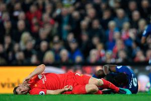Liverpool's English midfielder James Milner lies injured during the English Premier League football match between Liverpool and Manchester United at Anfield in Liverpool, north west England on October 17, 2016.AFP/Getty Images