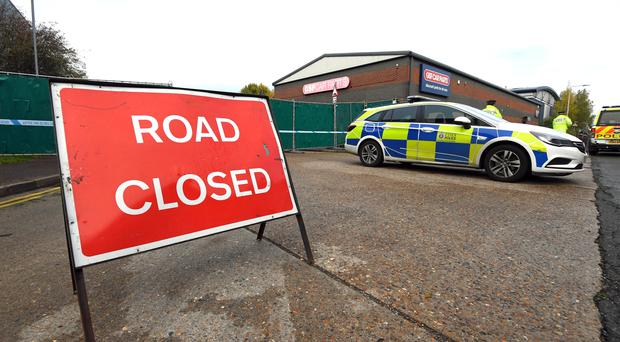 Police at the industrial estate in Grays on Eastern Avenue, Essex, where 39 bodies were discovered in a lorry.