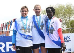 Pacemaker Press 1/5/2017  Local Women Laura Graham (centre) with runners up , Els Rens (left) and Salone Jepkoech Kimutai (right)  who wins the first lady runner   during the Belfast City Marathon on Bank Holiday Monday, with over 15,000 people taking part threw the streets of Belfast, with the Finish line at Ormeau Park. Pic Colm Lenaghan/Pacemaker