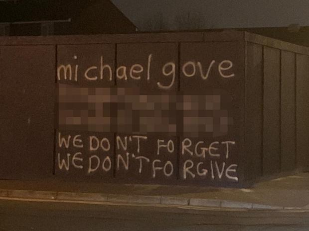 Graffiti messages revealing Michael Gove's address have  appeared in south Belfast's Sandy Row area