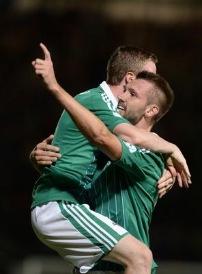 6/9/2013. PACEMAKER PRESS INTL.  Gareth McAuley rises to beat Ronaldo and score the equaliser scores during this evenings 2014 World Cup qualifier between Northern Ireland and Portugal at Windsor park, Belfast. Picture Charles McQuillan/Pacemaker.
