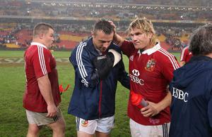 BRISBANE, AUSTRALIA - JUNE 08:  Tommy Bowe (L) of the Lions, who injured his right arm is commiserated by team mate Richard Hibbard after the match between the Queensland Reds and the British & Irish Lions at Suncorp Stadium on June 8, 2013 in Brisbane, Australia.  (Photo by David Rogers/Getty Images)