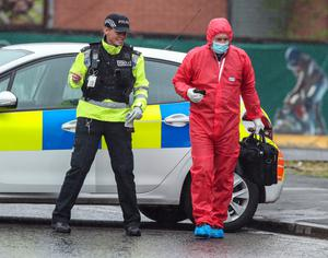 Police at the scene (Peter Byrne/PA)