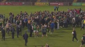 The scenes on the pitch following the Dungannon win. Pic BBC.