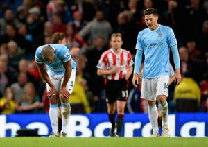 MANCHESTER, ENGLAND - APRIL 16:  A dejected Vincent Kompany and Javi Garcia of Manchester City during the Barclays Premier League match between Manchester City and Sunderland at Etihad Stadium on April 16, 2014 in Manchester, England.  (Photo by Michael Regan/Getty Images)