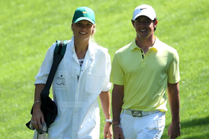 Rory McIlroy walks with his caddie Caroline Wozniacki during the Par 3 Contest prior to the start of the 2013 Masters Tournament at Augusta National Golf Club