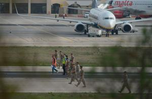 Members of Malta's Armed Forces check the runway after a small passenger aircraft crashed on takeoff at Malta's international airport on October 24, 2016, killing all five people onboard, officials said. / AFP PHOTO / Matthew Mirabelli / Malta OUTMATTHEW MIRABELLI/AFP/Getty Images