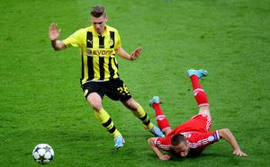 Borussia Dortmund's Lukasz Piszczek (left) and Bayern Munich's Franck Ribery battle for the ball during the UEFA Champions League Final at Wembley Stadium, London. PRESS ASSOCIATION Photo. Picture date: Saturday May 25, 2013.