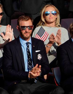 CHASKA, MN - SEPTEMBER 29: Dustin Johnson of the United States sits with Paulina Gretzky during the 2016 Ryder Cup Opening Ceremony at Hazeltine National Golf Club on September 29, 2016 in Chaska, Minnesota.  (Photo by Jamie Squire/Getty Images)