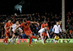 Liverpool's Steven Gerrard scores his sides third goal of the game during the Barclays Premier League match at Craven Cottage, London