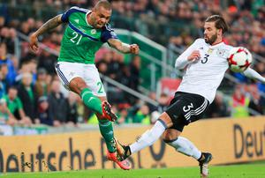 Northern Ireland's Josh Magennis and Germany's Marvin Plattenhardt in action during the World Cup Qualifier at Windsor Park in Belfast on October 4th 2017 (Photo by Kevin Scott / Belfast Telegraph)