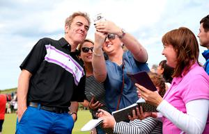 James Nesbitt poses for a photograph with fans during the Pro-Am day of the Dubai Duty Free Irish Open at Portstewart Golf Club. Niall Carson/PA Wire.