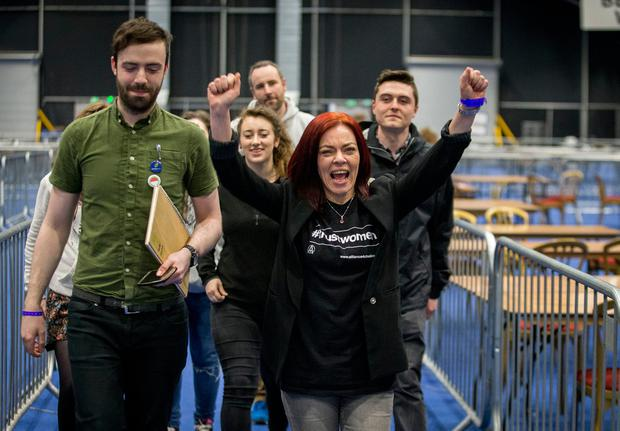Returned Green Party MLA Clare Bailey (right) celebrates with supporters at the Titanic Exhibition Centre, Belfast at the Northern Ireland Assembly election count. PA