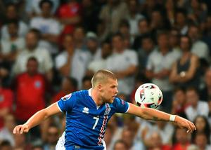 Iceland's forward Johann Berg Gudmundsson plays the ball during Euro 2016 round of 16 football match between England and Iceland at the Allianz Riviera stadium in Nice on June 27, 2016. / AFP PHOTO / ANNE-CHRISTINE POUJOULATANNE-CHRISTINE POUJOULAT/AFP/Getty Images