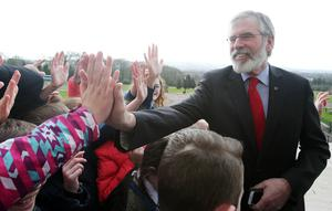 Northern Ireland parties return to Stormont after last eek's Assembly election.   Sinn Fein's president Gerry Adams meets school children on the steps of Stormont's Parliament Buildings, east Belfast.   Photo by Jonathan Porter / Press Eye.