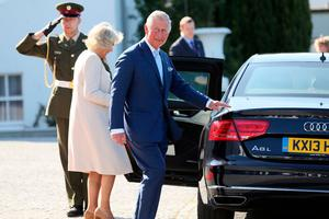 Britain's Prince Charles, Prince of Wales (C) and his wife Britain's Camilla, Duchess of Cornwall walk to their car after visiting Ireland's President, Michael D Higgins  and his wife Sabina at Aras an Uachtarain, the official residence of the President, in Pheonix Park, Dublin, on May 10, 2017. / AFP PHOTO / PAUL FAITHPAUL FAITH/AFP/Getty Images