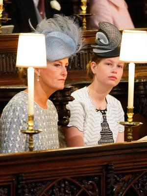 WINDSOR, UNITED KINGDOM - MAY 19: (L-R) Sophie, Countess of Wessex and Lady Louise Windsor take their seats at St George's Chapel at Windsor Castle before the wedding of Prince Harry to Meghan Markle on May 19, 2018 in Windsor, England. (Photo by  Jonathan Brady - WPA Pool/Getty Images)
