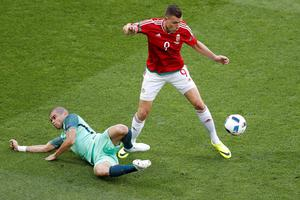 Hungary's Adam Szala, right, and Portugal's Pepe vie for the ball during the Euro 2016 Group F soccer match between Hungary and Portugal at the Grand Stade in Decines-Charpieu, near Lyon, France, Wednesday, June 22, 2016. (AP Photo/Michael Sohn)