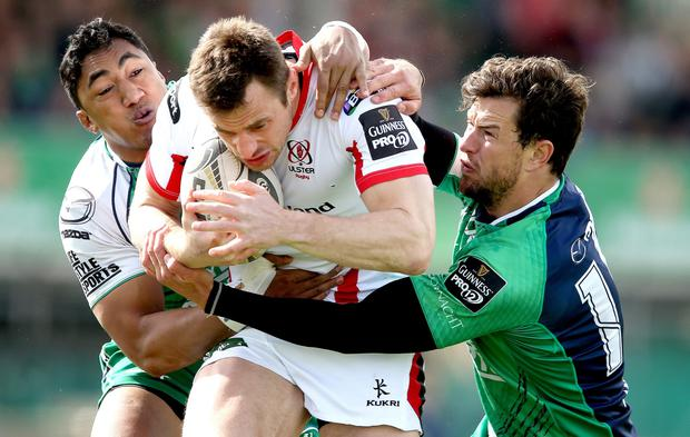 Connacht's Bundee Aki and Danie Poolman tackle Tommy Bowe of Ulster. INPHO/James Crombie.