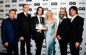 Nick Cave & The Bad Seeds with their Best Band award pose with Courtney Love during the GQ Men of the Year Awards 2017 held at the Tate Modern, London. PRESS ASSOCIATION Photo. Picture date: Tueday September 5th, 2017. Photo credit should read: Ian West/PA Wire
