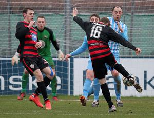 Coleraine Ian Parkhill fires a shot on the Warrenpoint Town goal during Saturday's Danske Bank Premiership match at  Milltown.